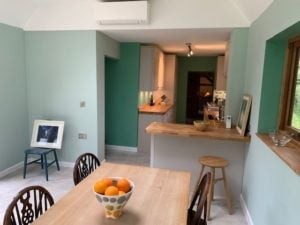 Modern Kitchen fitting, table in foreground, green and white walls, light wood worktops, KL and Sons Building Services, Devizes, Marlborough, Calne, Bath