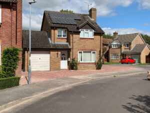 New red brick driveway and front of house with garage and solar panels on roof in cul-de-sac , KL and Sons Building Services, Devizes, Marlborough, Calne, Bath