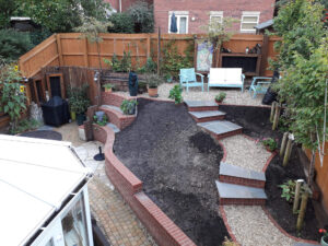 Landscaping; Completed garden with soil, paving, brick wall sand seating area, KL and Sons Building Services, Devizes, Marlborough, Calne, Bath